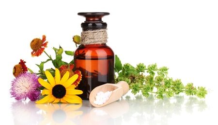 14953617 - medicine bottle with tablets and flowers isolated on white