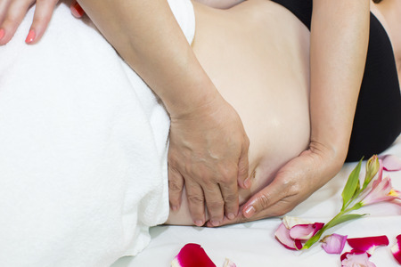 40881873 - processes salon doing massage to a pregnant woman