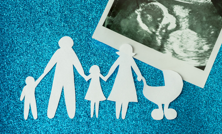 91860679 - paper image of happy families who are expecting another child.